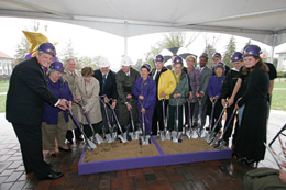 University administrators, donors and friends assembled under a tent on the Quad as the rain fell around them during the official ceremonial groundbreaking for the Forbes Center for the Performing Arts.